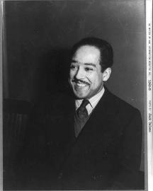 Langston Hughes, half-length portrait, facing left (1942)